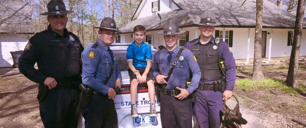 PHOTO: Arkansas State Troopers celebrate Toxey Ahrablis 10th birthday in Hot Springs Village, Arkansas on April 4, 2016.