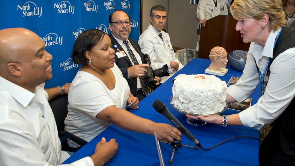 Raleigh Hall and his wife Tunicia celebrate her recovery after suffering a brain hemorrhage.