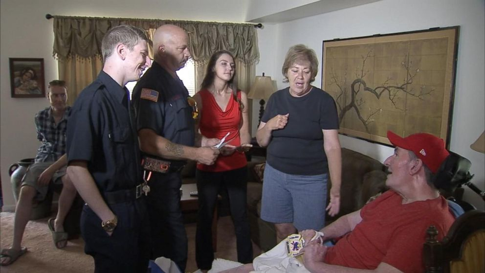 Firefighters Tim Young and Paul Hullings met waitress Liz Woodward's father, Steve, Sunday.
