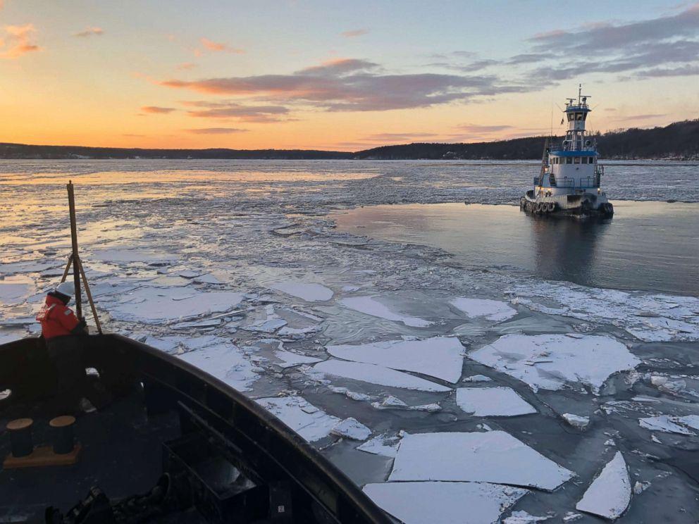 PHOTO: Coast Guard Cutter Penobscot Bay helps break free commercial tug Stephanie Dann from the ice on the Hudson River near Kingston, N.Y., Jan. 2, 2018.