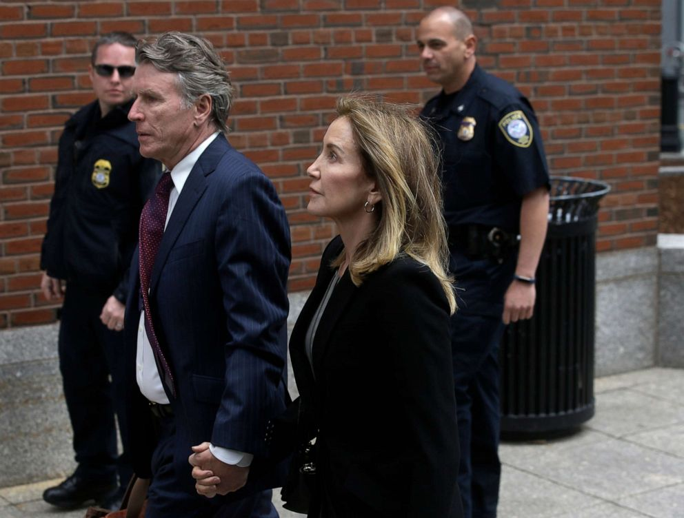 PHOTO: Felicity Huffman arrives with her brother Moore Huffman Jr., at federal court, May 13, 2019, in Boston, where she is scheduled to plead guilty to charges in a nationwide college admissions bribery scandal.