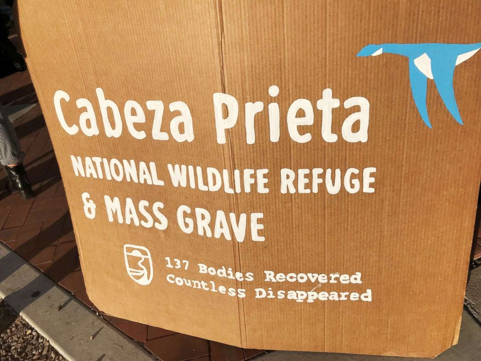 PHOTO: Supports of four humanitarian aid volunteers facing criminal charges for dropping off water at the Cabeza Prieta National Wildlife Refuge display this sign, showing the number of recovered human remains found in the remote desert wilderness.