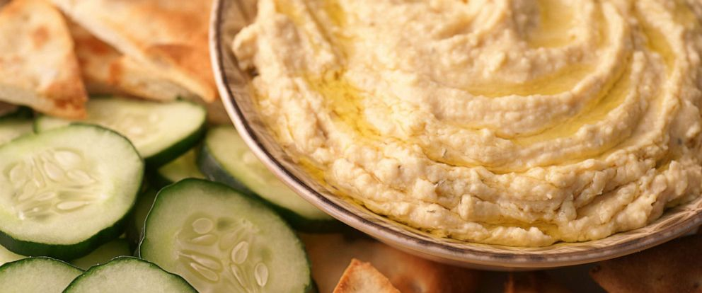 PHOTO: This file photo shows a bowl of hummus served with cucumbers and pita.