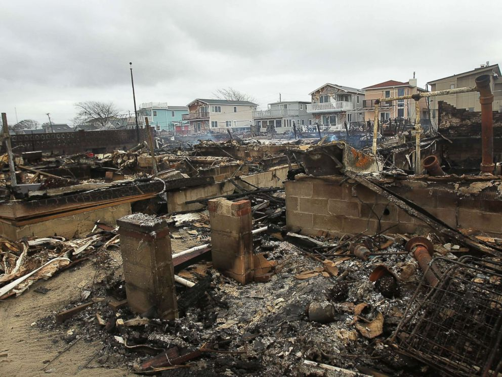 PHOTO: Homes sit smoldering after Hurricane Sandy on Oct. 30, 2012 in the Breezy Point Neighborhood of the Queens borough of New York City.