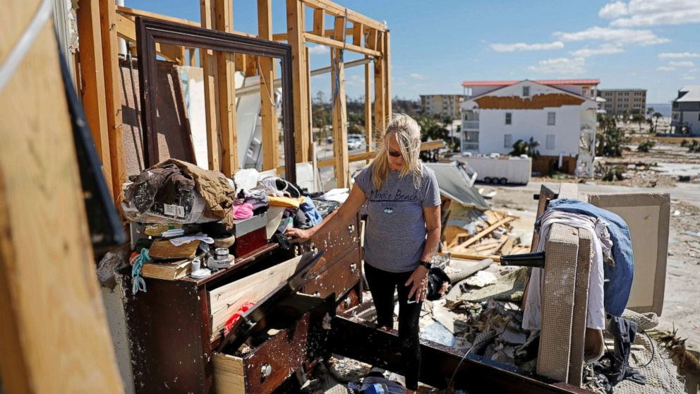 Candace Phillips sifts through what was her third-floor bedroom while returning to her damaged home in Mexico Beach, Fla., Oct. 14, 2018, in the aftermath of Hurricane Michael.
