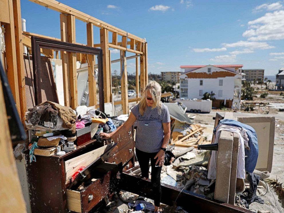 PHOTO: Candace Phillips sifts through what was her third-floor bedroom while returning to her damaged home in Mexico Beach, Fla., Oct. 14, 2018, in the aftermath of Hurricane Michael.