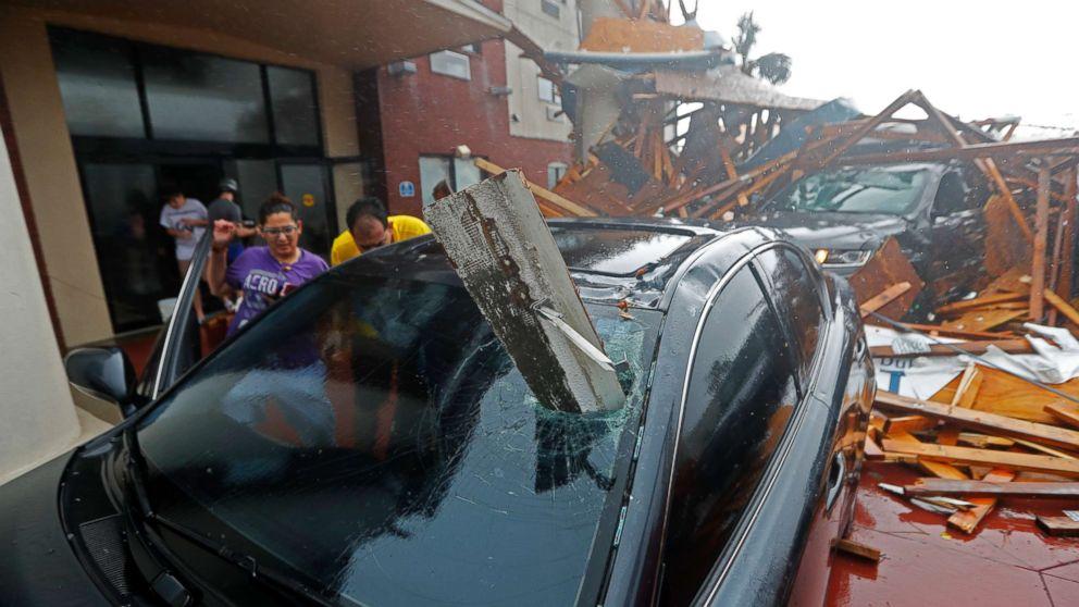 A woman checks on her vehicle as Hurricane Michael passes through in Panama City Beach, Fla., Oct. 10, 2018.
