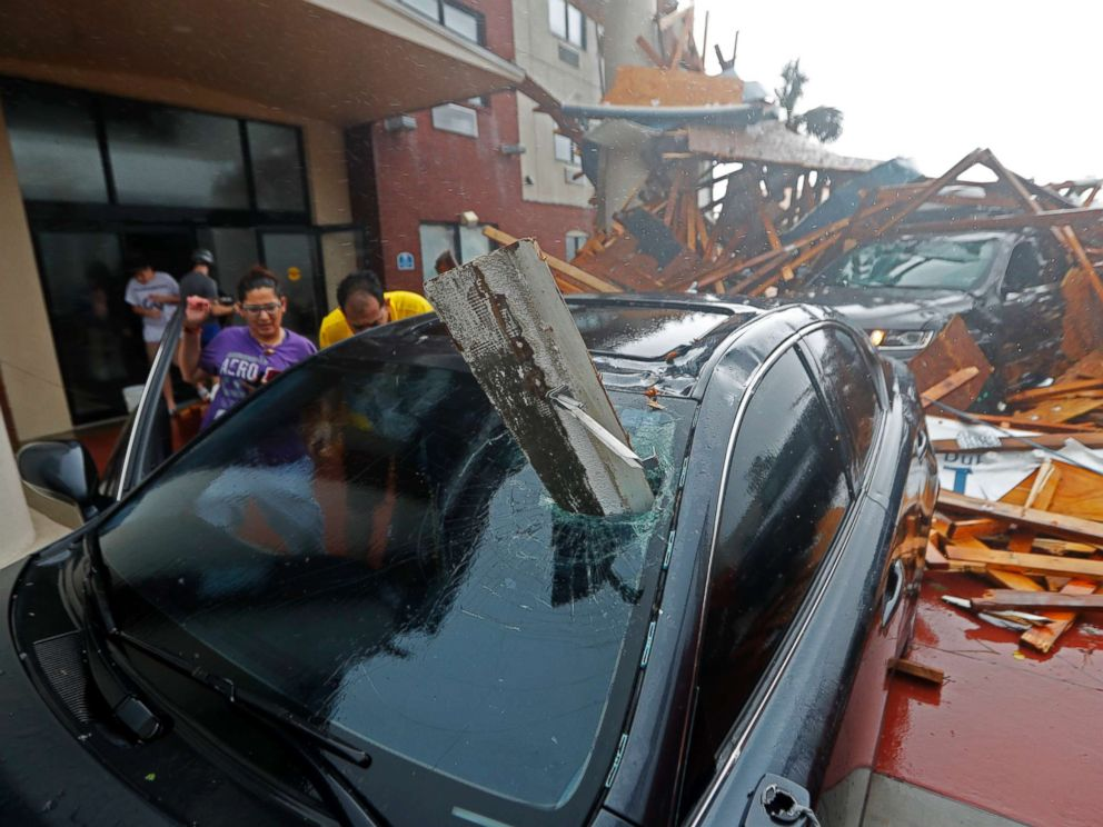 Gerald Herbert  APA woman checks on her vehicle as Hurricane Michael passes through in Panama City Beach Fla. Oct. 10 2018