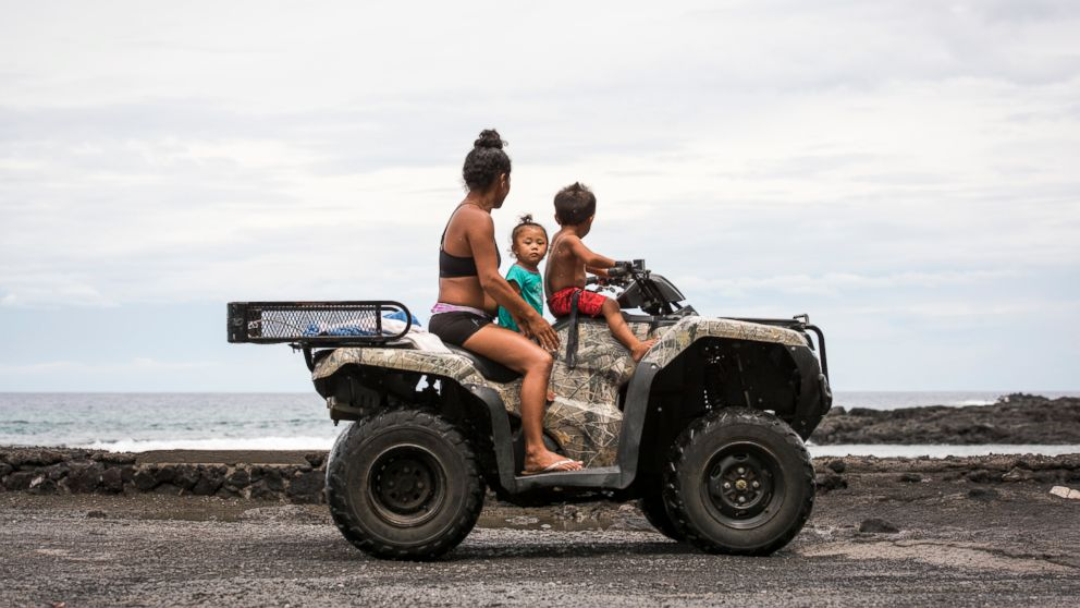People watch for the arrival of Hurricane Lane in Miloli'i, Hawaii, Aug. 23, 2018. Hurricane Lane drenched Hawaii  ahead of its arrival in the island state, prompting President Donald Trump to declare a state of emergency as landslides and flash flooding left roads blocked.
