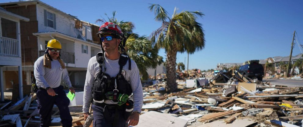 PHOTO: Search and rescue workers walk amidst the destruction left by Hurricane Michael in Mexico Beach, Fla., Oct. 13, 2018.