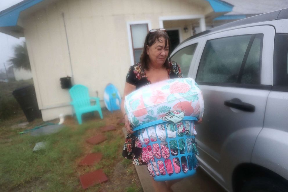PHOTO: Kathy Eaton takes what she can from her home as she tries to get out of the way of the storm as hurricane Michael approaches, Oct. 10, 2018, in Panama City Beach, Fla.