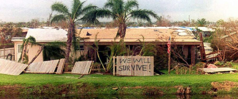 "PHOTO: A sign in front of a house in the Cutler Ridge area damaged by Hurricane Andrew reads ""We will survive,"" Aug. 26, 1992."
