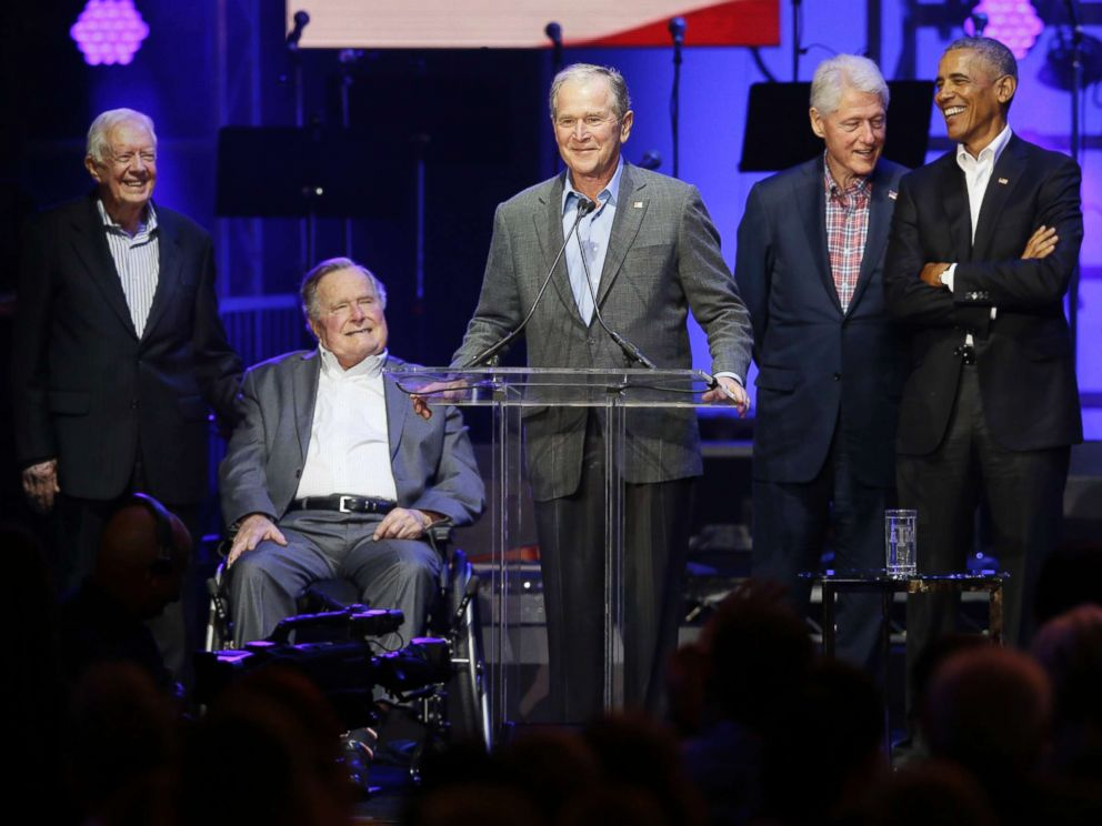 PHOTO: Former President George W. Bush, center, speaks as fellow former Presidents from right, Barack Obama, Bill Clinton, George H.W. Bush and Jimmy Carter look on during a hurricanes relief concert in College Station, Texas, Oct. 21, 2017.