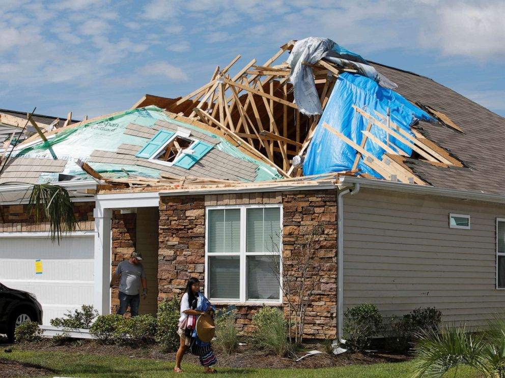 PHOTO: A girl removes personal belongings from her damaged home after a tornado spawned by Hurricane Dorian ripped apart her roof in Carolina Shores, N.C., Sept. 6, 2019.