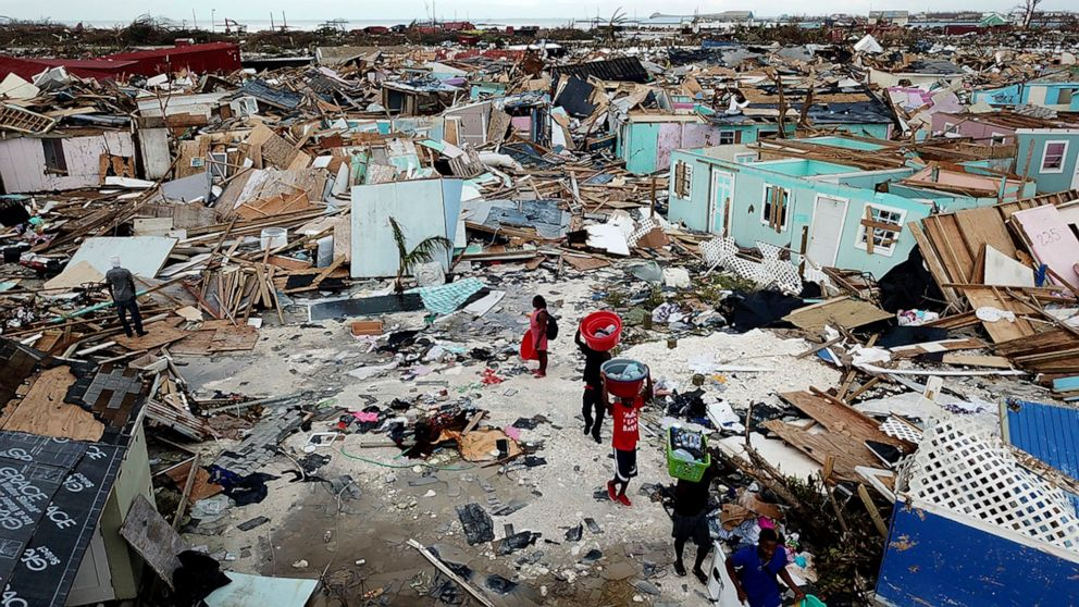 PHOTO: People search for salvageable items as they make their way through an area destroyed by Hurricane Dorian at Marsh Harbour in Great Abaco Island, Bahamas on Thursday, Sept. 5, 2019.