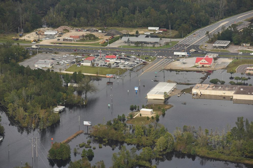 PHOTO: In this Sept. 24, 2018 photo, flood waters from the Neuse River cover the area in Kinston, N.C., a week after Hurricane Florence struck.