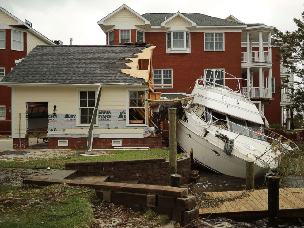 PHOTO: A boat lays smashed against a car garage, deposited there by the high winds and storm surge from Hurricane Florence along the Neuse River, Sept. 15, 2018, in New Bern, N.C.