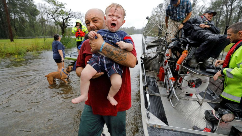 Oliver Kelly, 1, cries as he is carried off the sheriff's airboat during his rescue from rising flood waters in the aftermath of Hurricane Florence in Leland, North Carolina, Sept. 16, 2018.