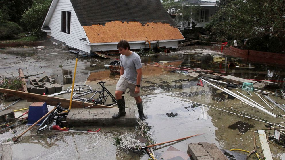Joseph Eudi looks at flood debris and storm damage from Hurricane Florence at a home on East Front Street in New Bern, N.C., Sept. 15, 2018.