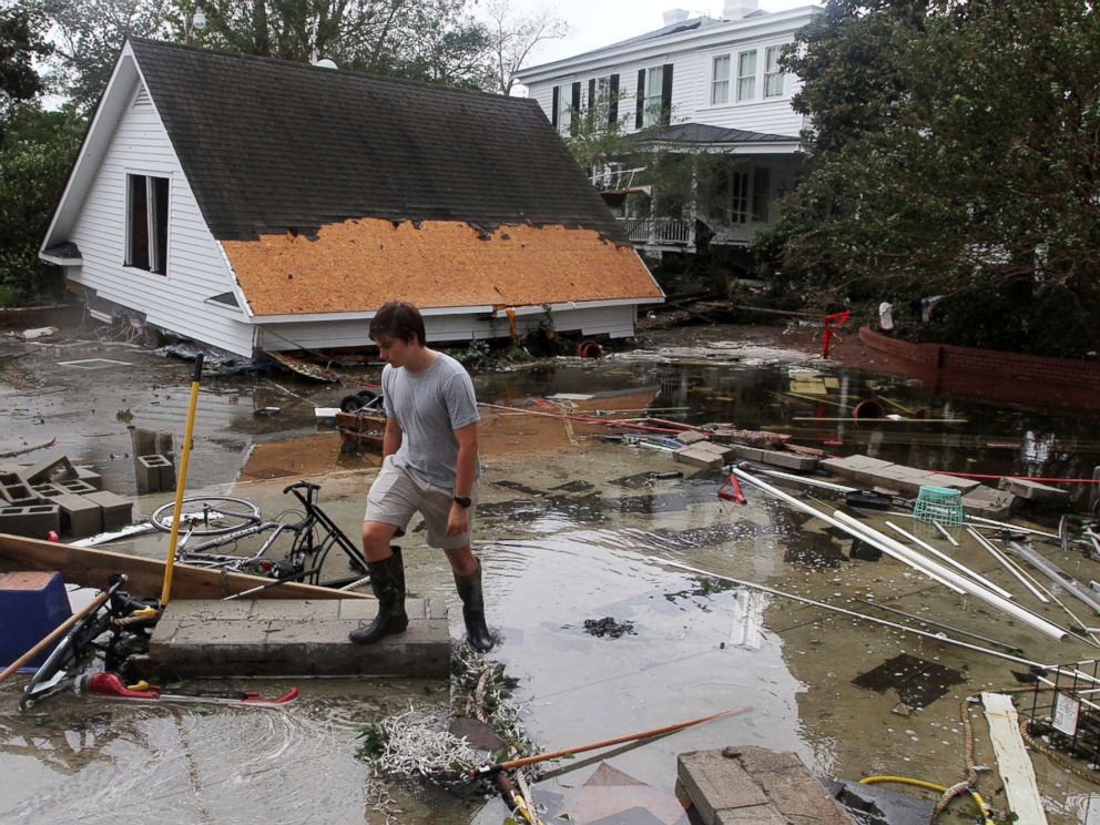 PHOTO: Joseph Eudi looks at flood debris and storm damage from Hurricane Florence at a home on East Front Street in New Bern, N.C., Sept. 15, 2018.