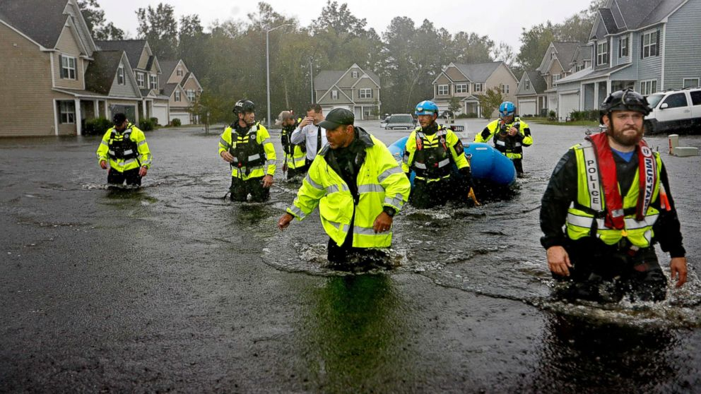 Members of the North Carolina Task Force urban search and rescue team wade through a flooded neighborhood looking for residents who stayed behind as Hurricane Florence continues to dump heavy rain in Fayetteville, N.C., Sept. 16, 2018.