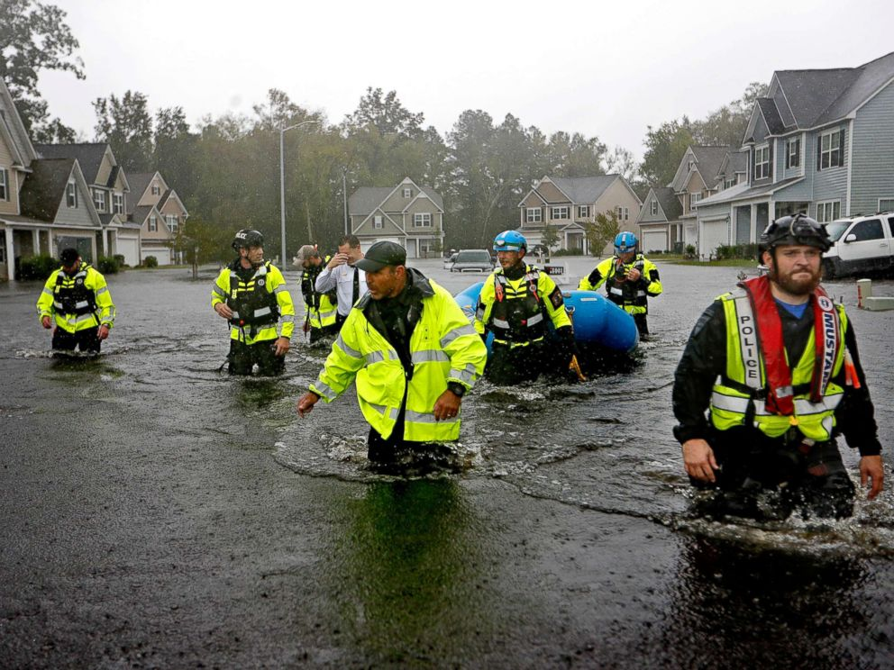 PHOTO: Members of the North Carolina Task Force urban search and rescue team wade through a flooded neighborhood looking for residents who stayed behind as Hurricane Florence continues to dump heavy rain in Fayetteville, N.C., Sept. 16, 2018.