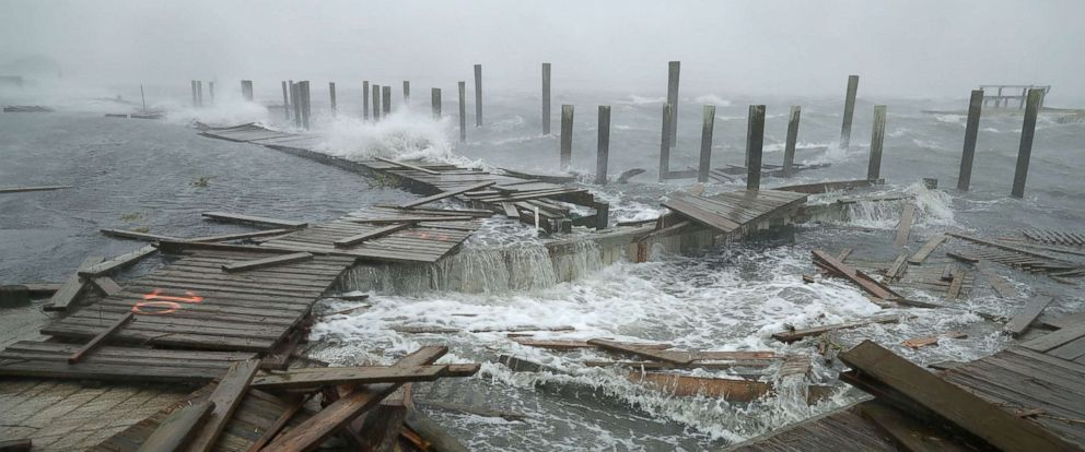 PHOTO: Portions of a boat dock and boardwalk are destroyed by powerful wind and waves as Hurricane Florence arrives in Atlantic Beach, N.C., Sept. 13, 2018.