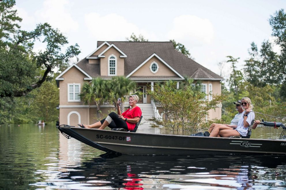 PHOTO: People navigate floodwaters caused by Hurricane Florence near the Waccamaw River on Sept. 23, 2018 in Conway, South Carolina.