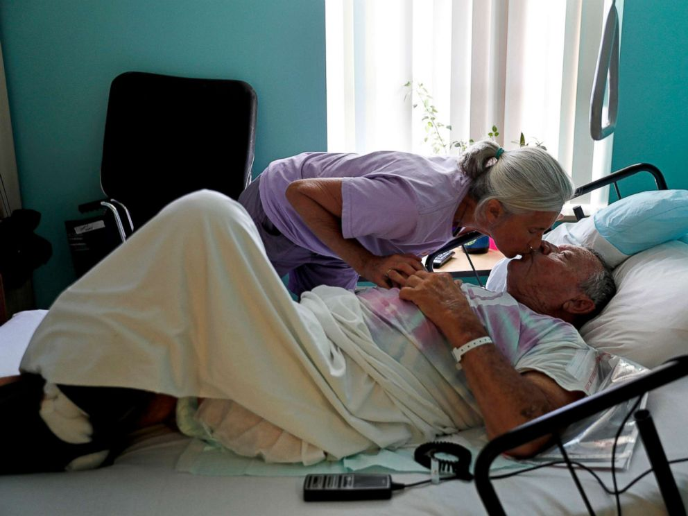 PHOTO: Marge Brown, 65, says goodbye to her father, George Brown, 90, before he is evacuated from a healthcare home in Morehead City, N.C., Sept. 12, 2018, as Hurricane Florence approaches the east coast.
