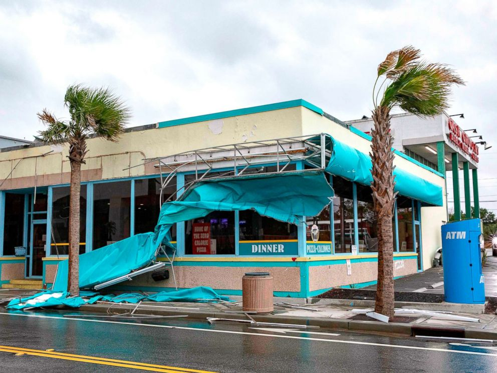 PHOTO: Storm damage caused by high winds is seen on Ocean Avenue as the outer bands of Hurricane Florence make landfall on Sept. 14, 2018, in Myrtle Beach, S.C.