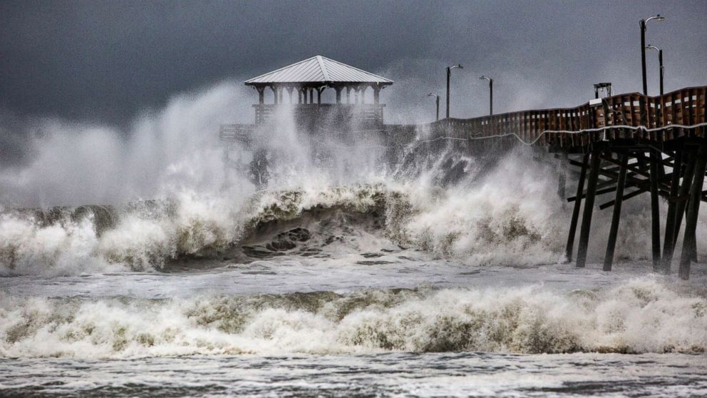 Waves slam the Oceana Pier & Pier House Restaurant in Atlantic Beach, N.C.,  Sept. 13, 2018 as Hurricane Florence approaches the area.