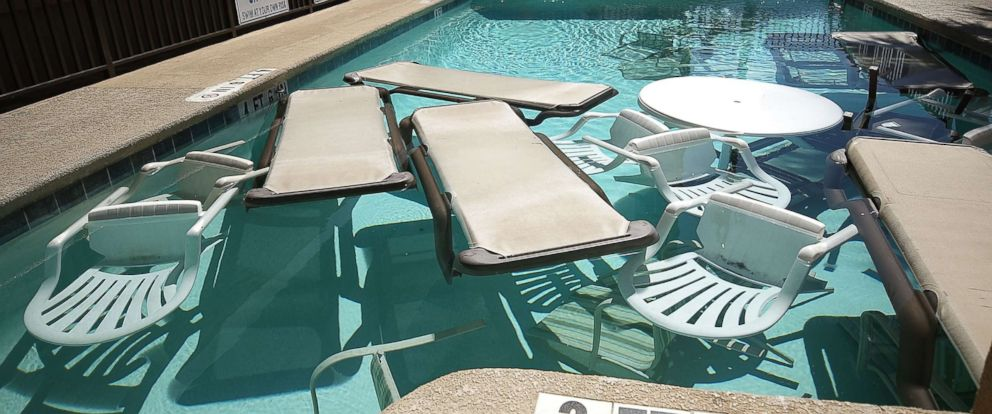 PHOTO: Poolside furniture is placed in the pool of a hotel ahead of the approaching Hurricane Florence on Sept. 12, 2018 in Myrtle Beach South Carolina.