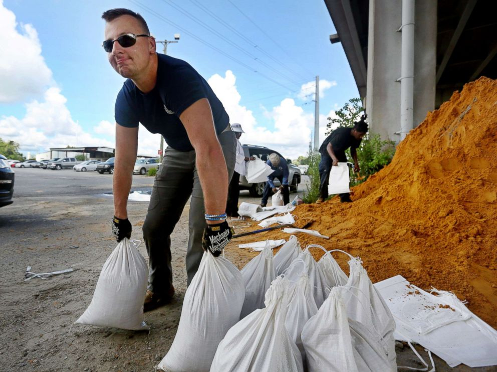 PHOTO: Kevin Orth loads sandbags into cars on Milford Street as he helps residents prepare for Hurricane Florence, Sept. 10, 2018, in Charleston, S.C.