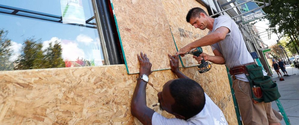PHOTO: Workers are seen as they work to secure plywood ahead of the arrival of Hurricane Florence in Wilmington, North Carolina, Sept. 12, 2018.