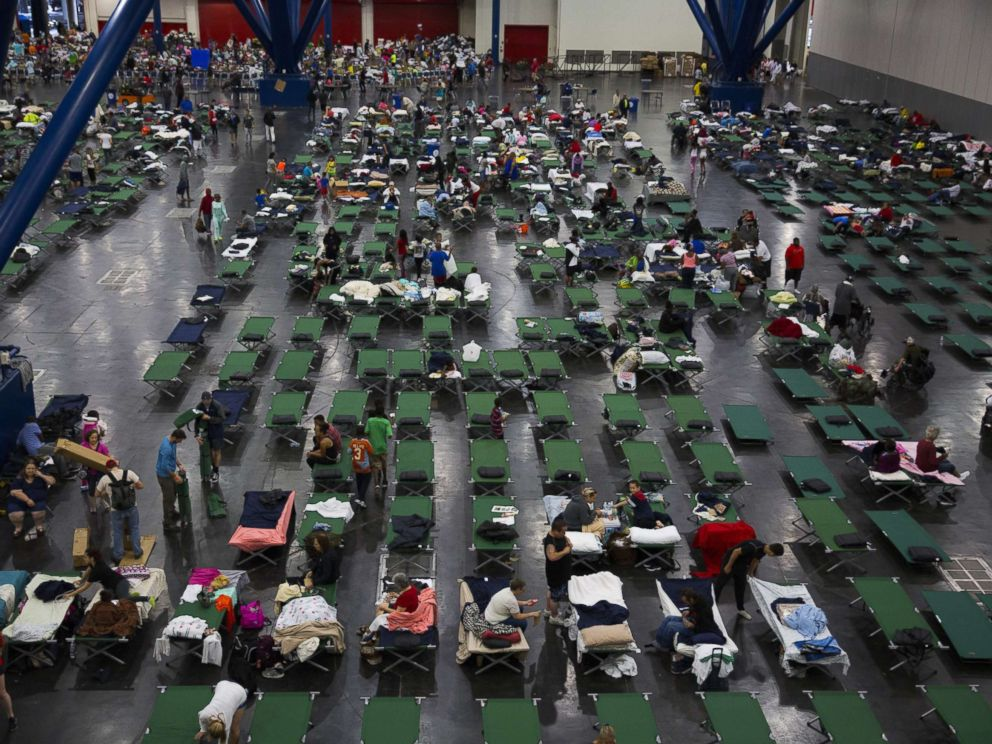 PHOTO: Evacuees fill up cots at the George Brown Convention Center that has been turned into a shelter run by the American Red Cross to house victims of Hurricane Harvey, Aug. 28, 2017, in Houston.