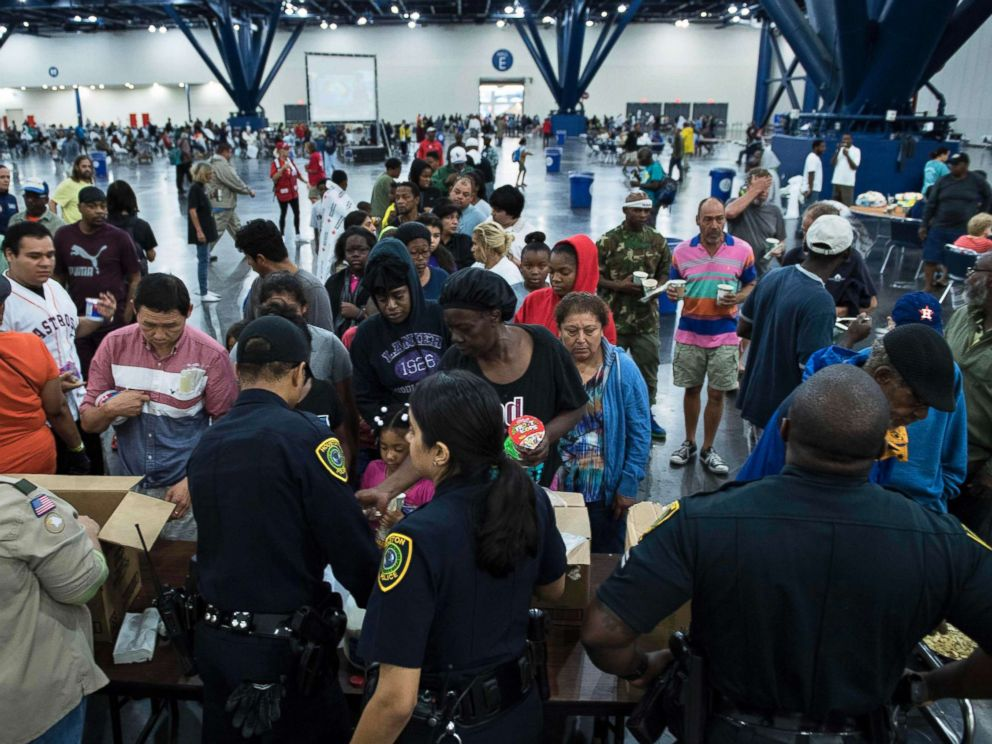 PHOTO: Flood victims gather for food at a shelter in the George R. Brown Convention Center during the aftermath of Hurricane Harvey, August 28, 2017, in Houston, Texas.