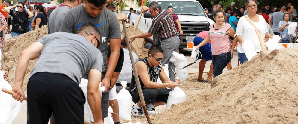 PHOTO: Residents prepare for Hurricane Harvey as they wait in line to shovel and fill sandbags, Aug. 24, 2017, at the Brownsville Public Library Main Branch parking lot, Brownsville, Texas.
