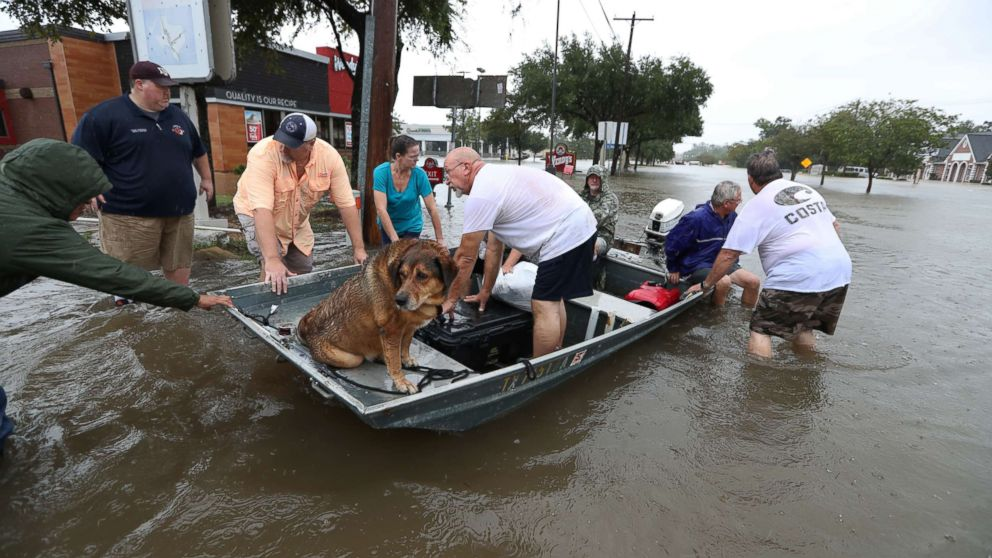 Neighbors are using their personal boats to rescue flooded Friendswood residents, Aug. 27, 2017, in Friendswood, Texas.
