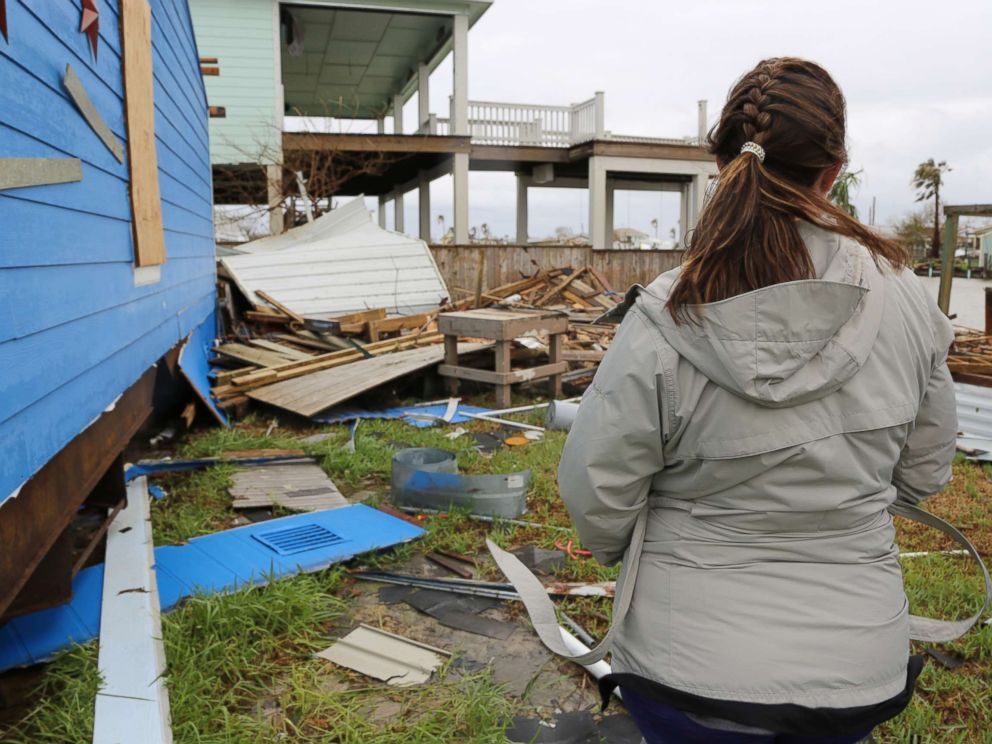 PHOTO: Christina and Jared Jellison assess damage to their vacation home caused by Hurricane Harvey in Rockport, Texas on Aug. 28, 2017.