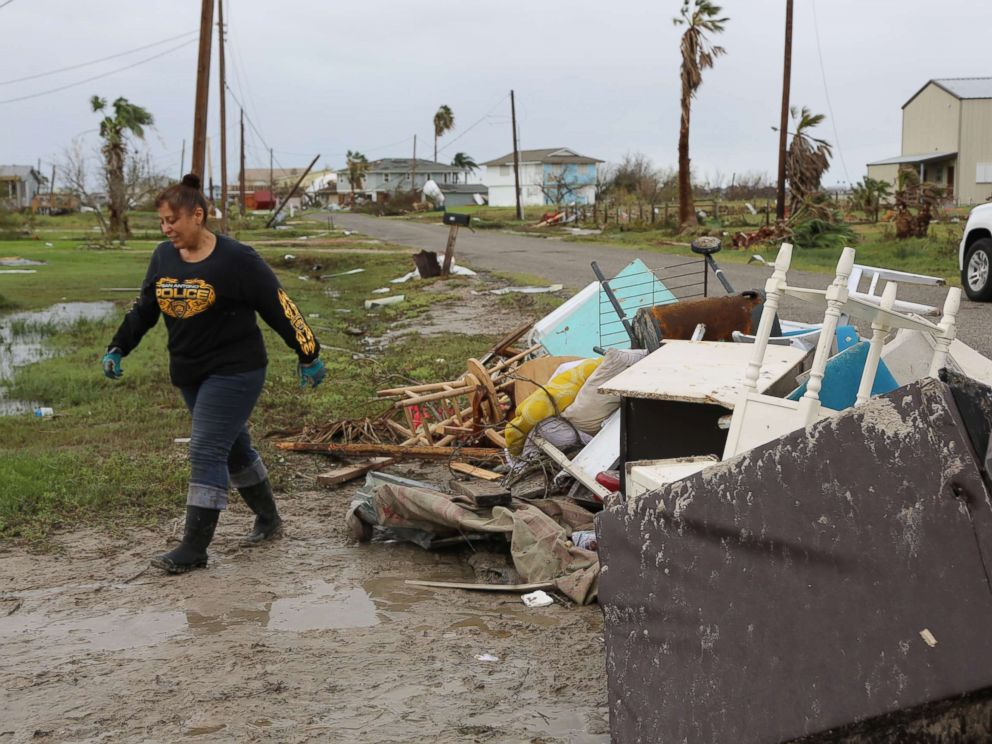 PHOTO: Christina and Robert Urdiales clean up debris around their destroyed second home in Rockport, Texas on Monday, August 28. They had planned to retire there before Hurricane Harvey hit.