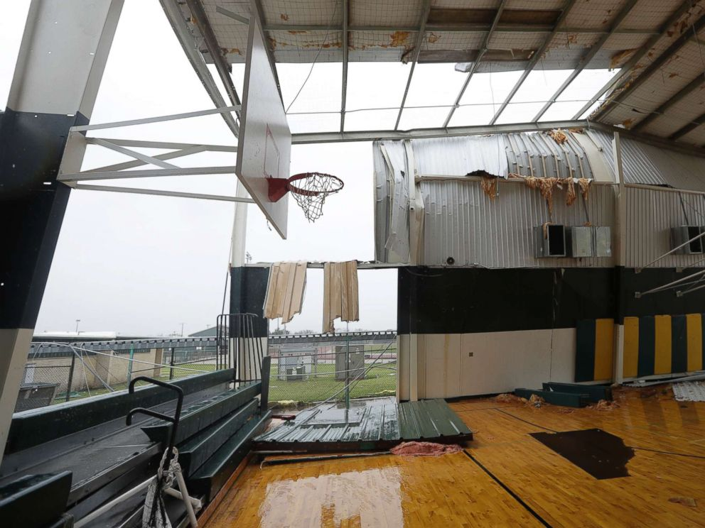 PHOTO: The basketball facility for Rockport High School is exposed to the outside after it lost part of its roof and walls from Hurricane Harvey, Aug. 26, 2017, in Rockport, Texas.