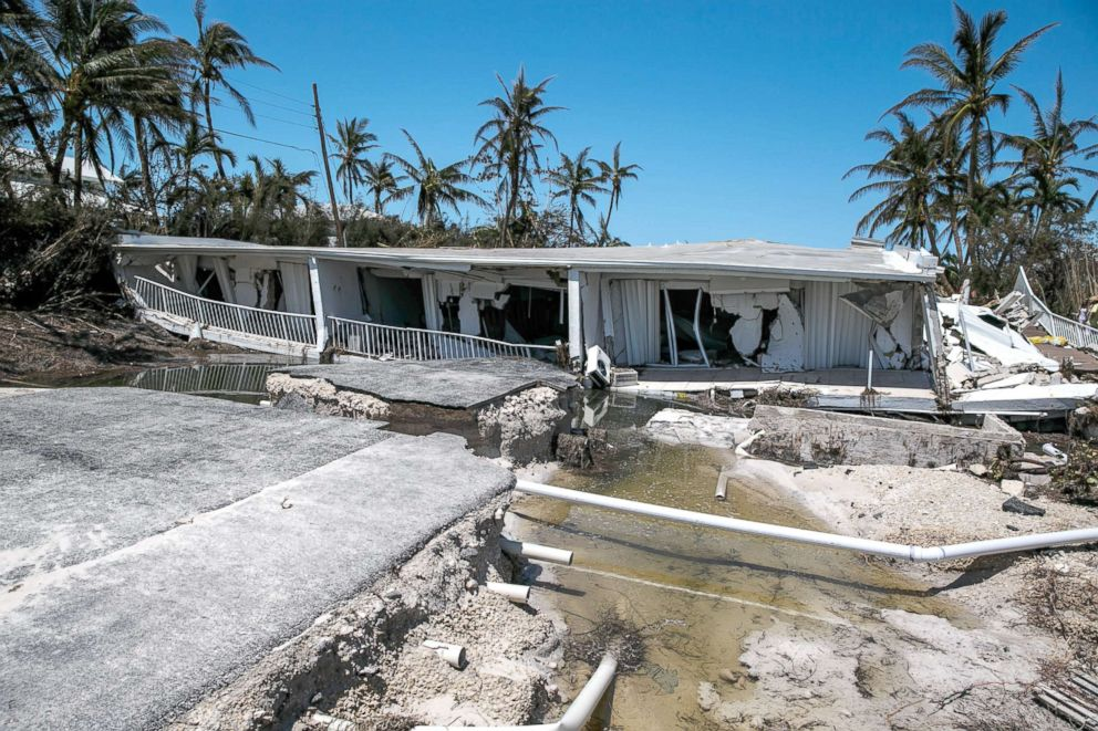In this file photo, a 3-story condominium has collapsed after Hurricane Irma send a storm surge and eroded the building foundations, in Islamorada, Florida Keys, Sept. 12, 2017.