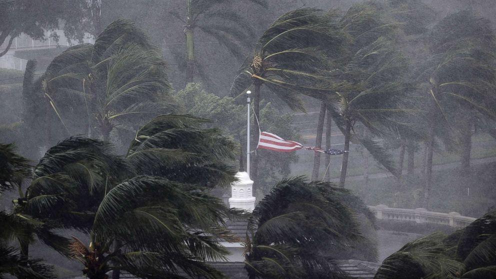 An American flag is torn as Hurricane Irma passes through Naples, Fla., Sept. 10, 2017.