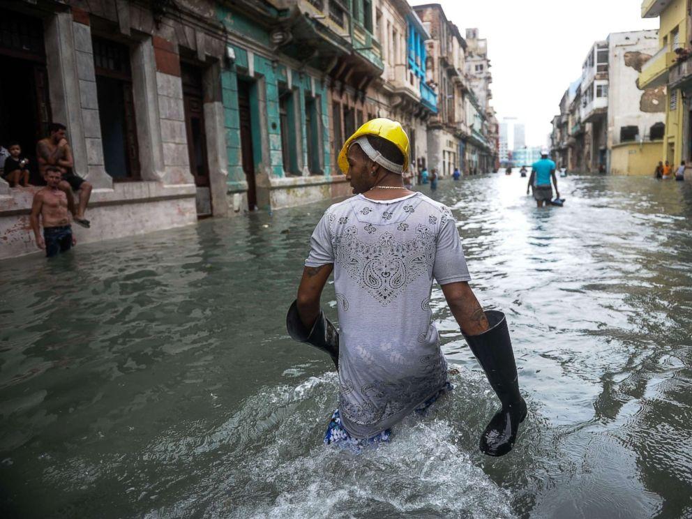 PHOTO: Cubans wade through a flooded street in Havana, Sept. 10, 2017.