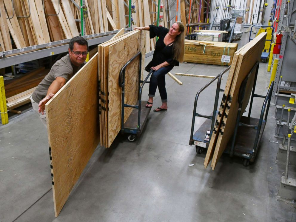PHOTO: Wes and Davina Hardin of Palm Bay are buying plywood and other hurricane supplies in preparation for Hurricane Irma on Sept. 4, 2017, at the Melbourne Lowes Home Improvement Store on Minton Road, Fla.