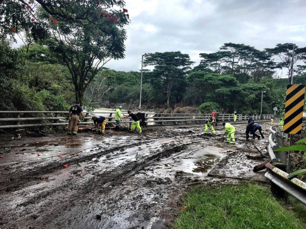 In this photo provided by Jessica Henricks, crews work at clearing damage from Hurricane Lane Friday, Aug. 24, 2018, near Hilo, Hawaii.