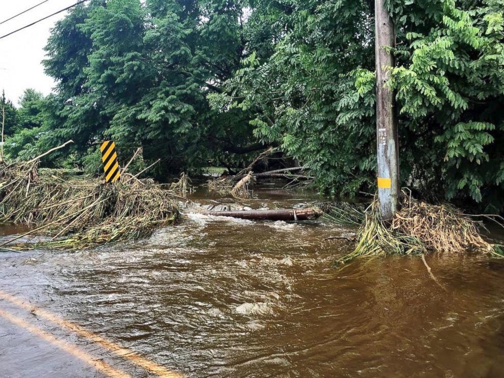 In this photo provided by Jessica Henricks, is flooding and damage from Hurricane Lane Friday, Aug. 24, 2018, near Hilo, Hawaii.