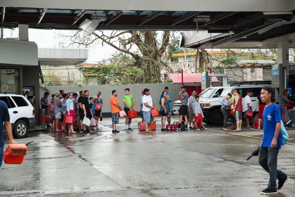 People line up to fill gas cans after Hurricane Maria in San Juan, Puerto Rico, Sept. 21, 2017.