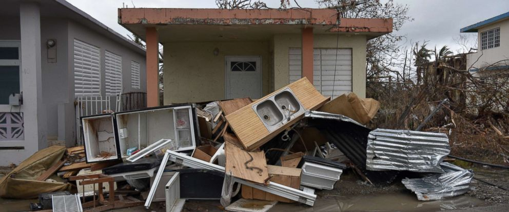 PHOTO: Damaged furniture is seen in front of a house in Punta Santiago, Humacao, Puerto Rico, Sept. 27, 2017, one week after the passage of Hurricane Maria.