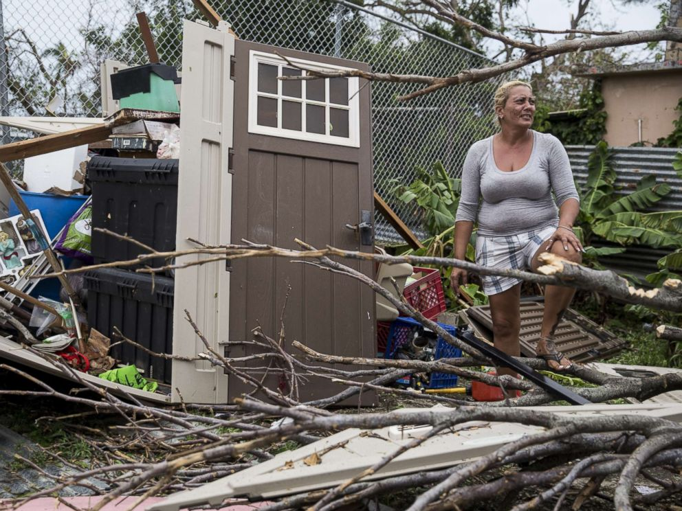 PHOTO: A resident surveys the damage on her property after Hurricane Maria made landfall, Sept. 21, 2017, in the Guaynabo suburb of San Juan, Puerto Rico.